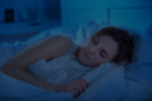 Woman Sleeping in Dark Room