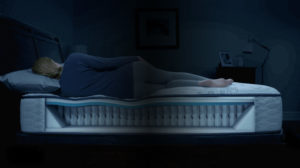 Woman Sleeping on comfortable mattress