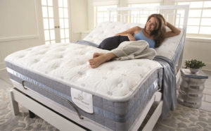 Woman Laying on Adjustable Bed